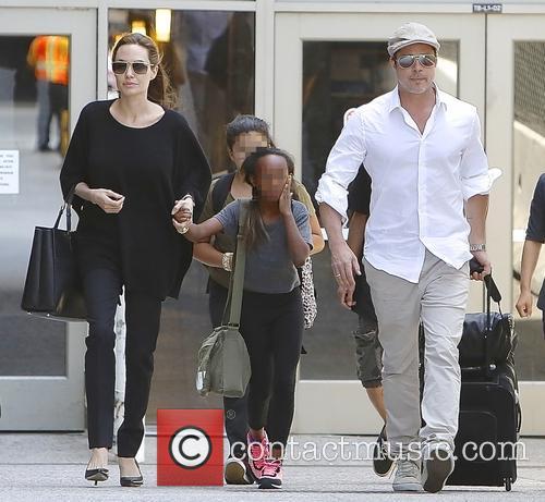 Angelina Jolie, Brad Pitt and Zahara Jolie-pitt 8