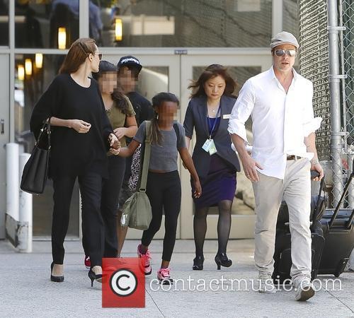 Angelina Jolie, Brad Pitt, Zahara Jolie-pitt and Maddox Jolie-pitt 4