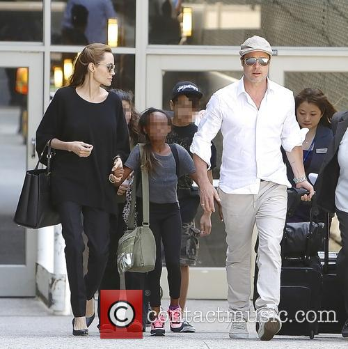 Angelina Jolie, Brad Pitt, Zahara Jolie-pitt and Maddox Jolie-pitt 10