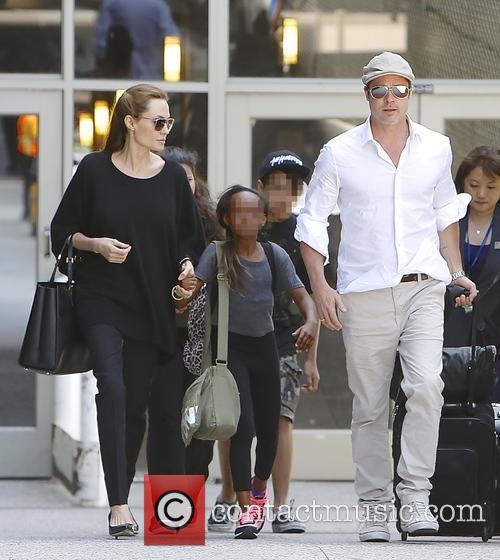 Angelina Jolie, Brad Pitt, Zahara Jolie-pitt and Maddox Jolie-pitt
