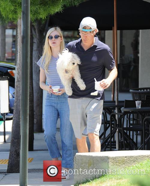 Elle Fanning treats her father Steven Fanning to...
