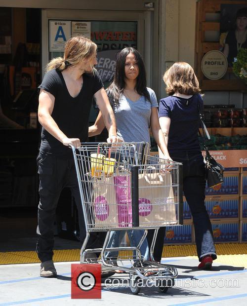 EXCLUSIVE Zoe Saldana and husband Marco Perego go...