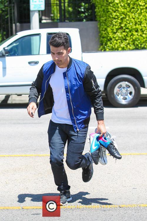 Joe Jonas Heads To Watch The 2014 FIFA...