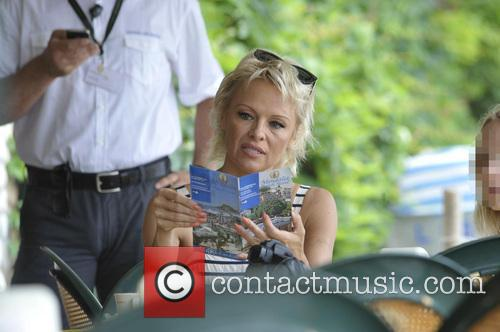 Pamela Anderson visits the beach and goes for...