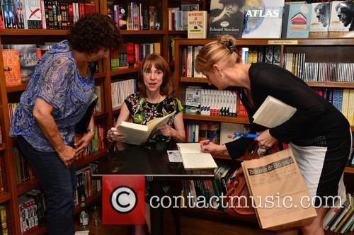 Lisa Lee signs copies of her book 'China...