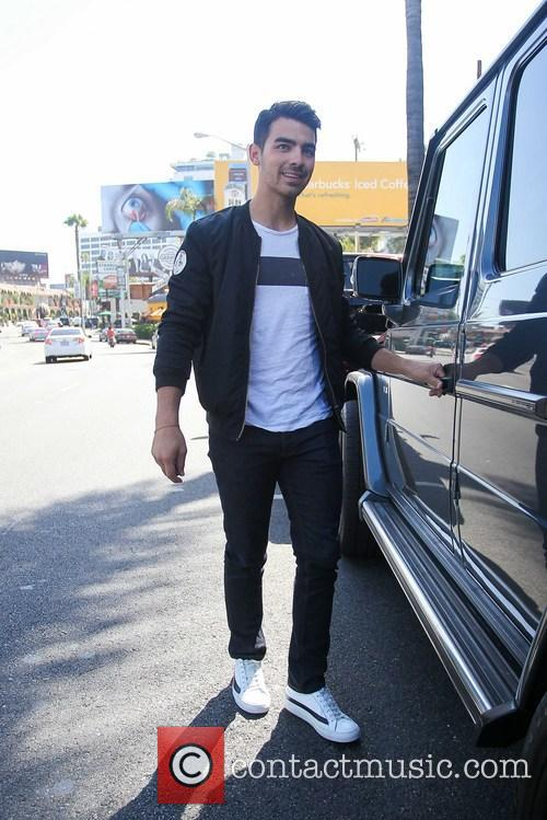 Joe Jonas Leaves An Office Building