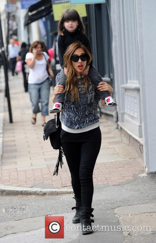 Myleene Klass appears in good spirits while out...