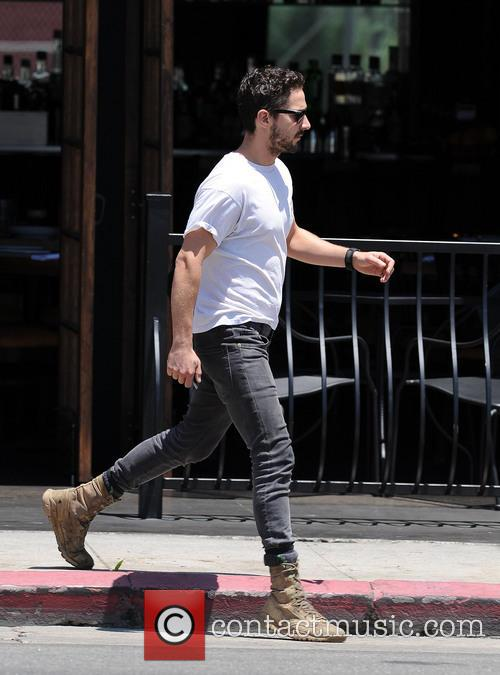Shia LaBeouf out and about wearing sunglasses in...