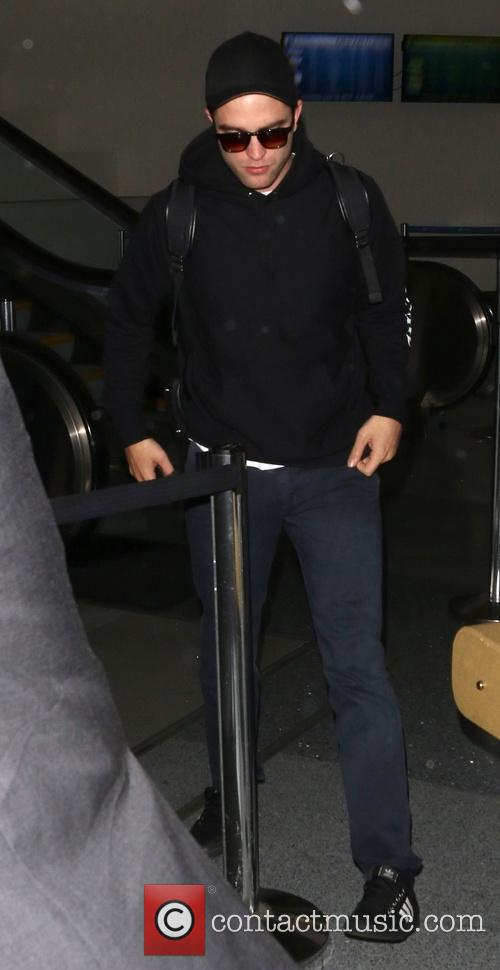 Robert Pattinson At Los Angeles International Airport