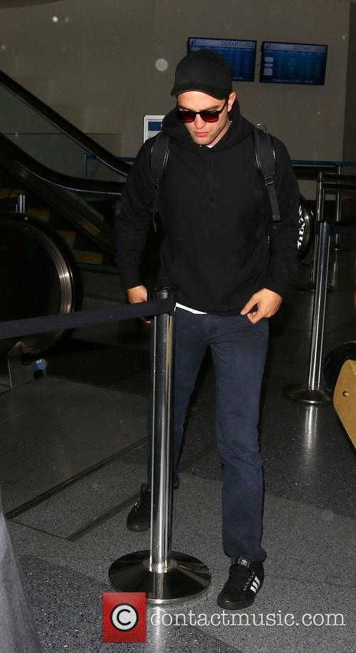 Robert Pattinson At Los Angeles International Airport