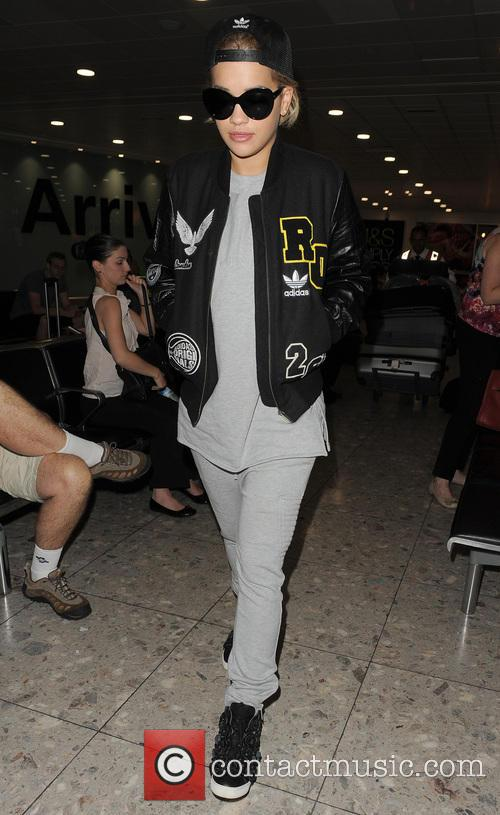 Rita Ora and Michelle Rodriguez arriving at Heathrow...