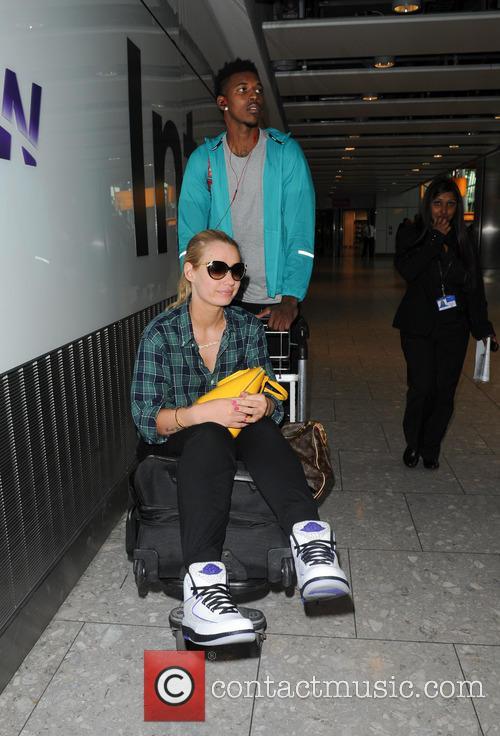 Iggy Azalea and Nick Young arriving at Heathrow