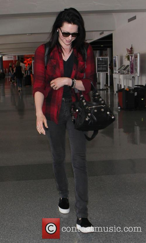 Laura Prepon arrives at Los Angeles International (LAX)...