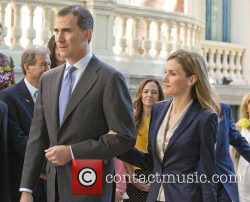 Spain's King Felipe VI and Queen Letizia attend...