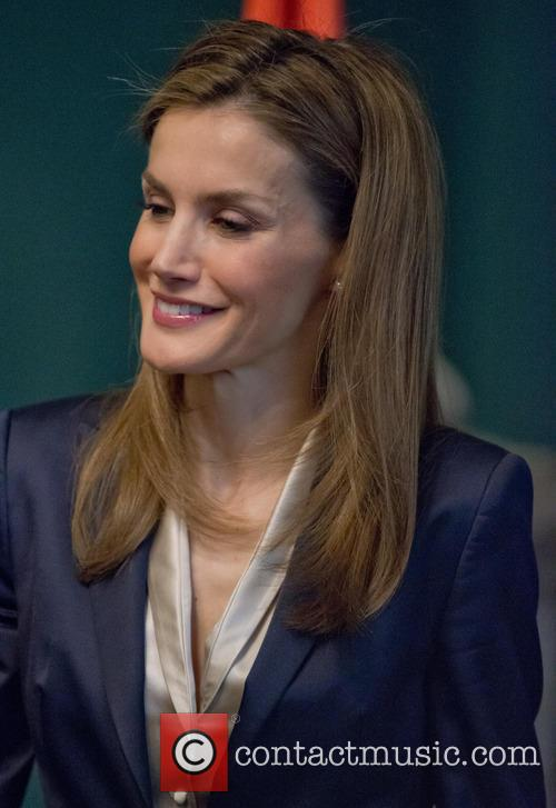Spain's King Felipe VI and Queen Letizia attend...