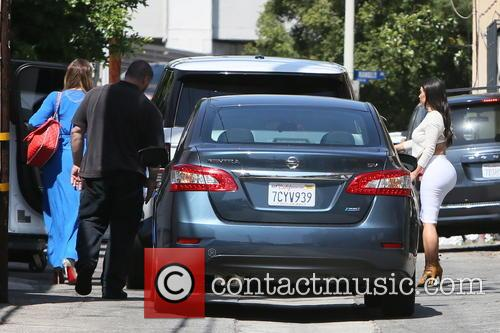 Kim Kardashian and Khloe Kardashian seen leaving the...