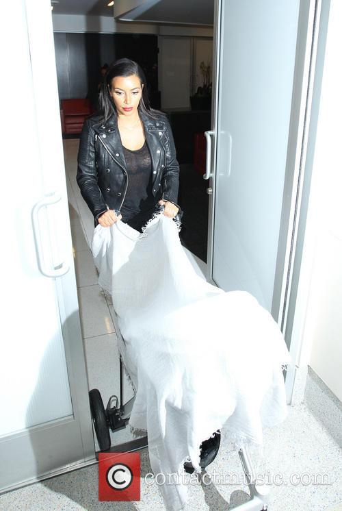 Kim Kardashian and baby North West arrive at...