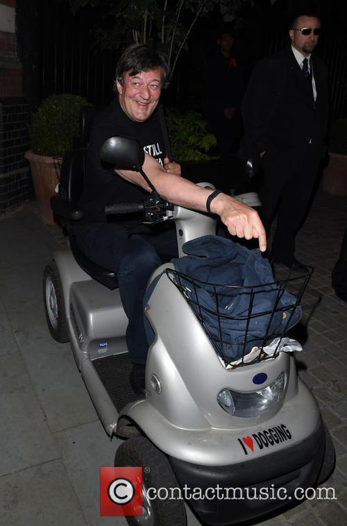 Stephen Fry Riding Mobility Scooter