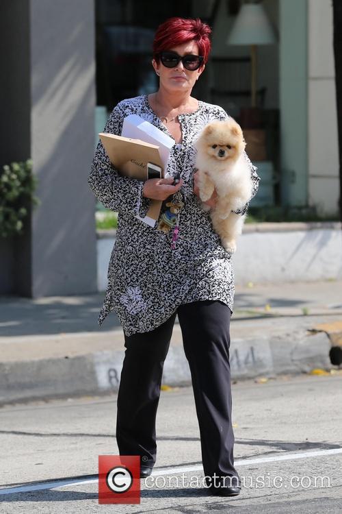 Sharon Osbourne walks to her car with her...