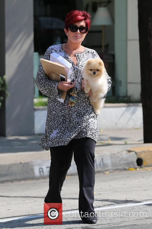 Sharon Osbourne walks to her car with her...