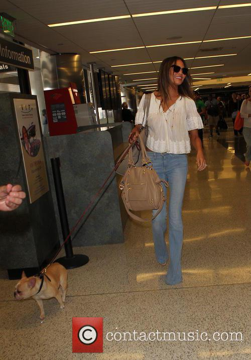 Chrissy Teigen and her pet dog arrive at...