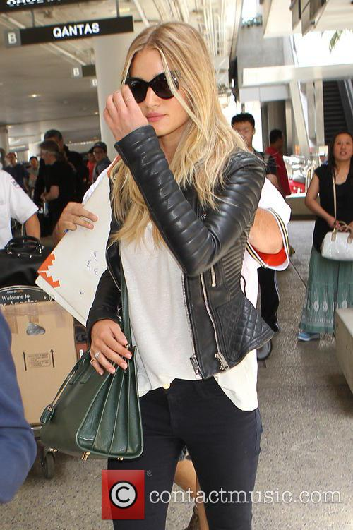 Rosie Huntington-Whiteley arrives at Los Angeles International Airport...