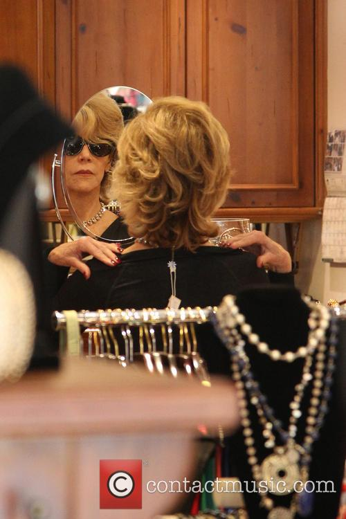 Jane Fonda tries on accessories at a Beverly...