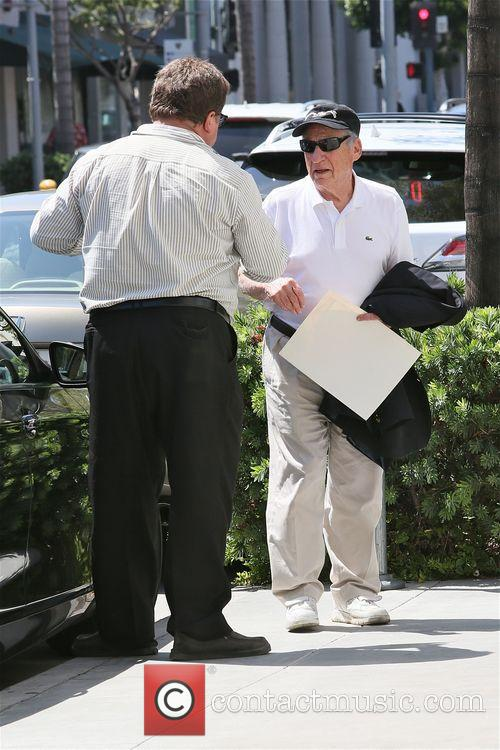 Mel Brooks leaves lunch with a few gifts...