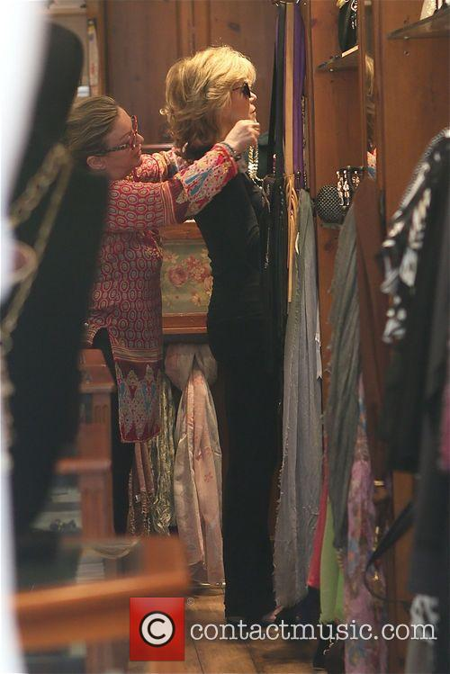 Jane Fonda tries on accessories at Victorian Rose