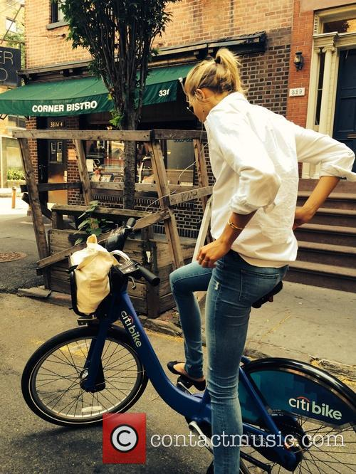 Karlie Kloss riding a Citibike