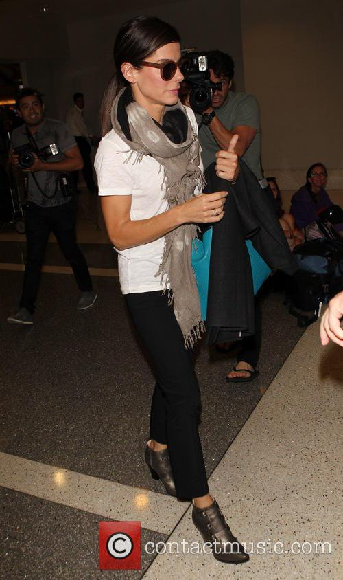 Sandra Bullock arrives at Los Angeles International (LAX)...