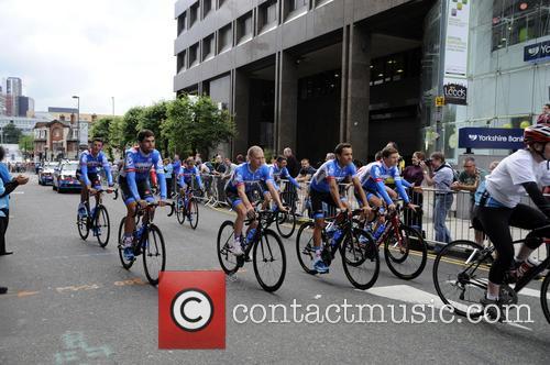 Tour de France teams take part in a...