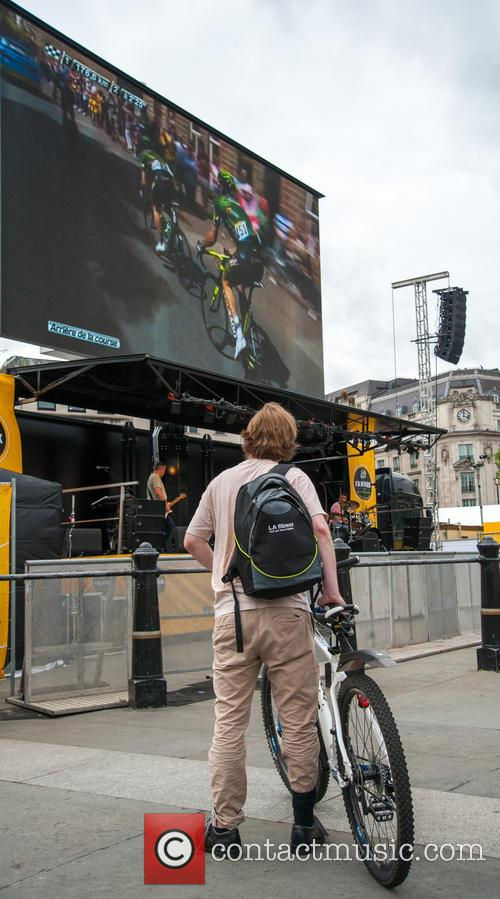 Londoners watch the Tour de France from the...