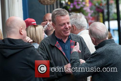 Madness frontman Suggs has a drink in Soho