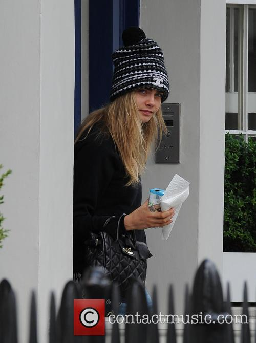 Cara Delevingne leaving home