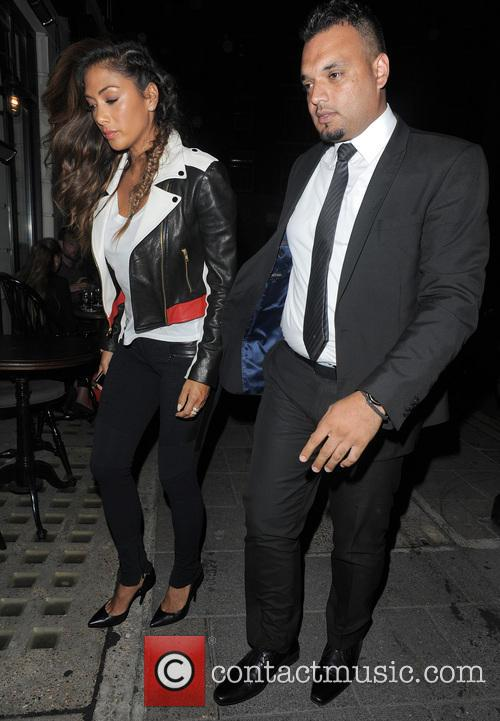 Tom Cruise and Nicole Scherzinger leaving Little House...