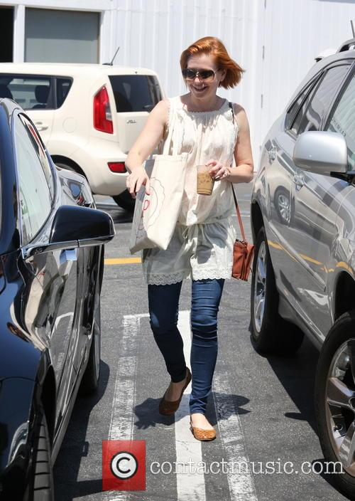 Alyson Hannigan and her whole family go grocery...