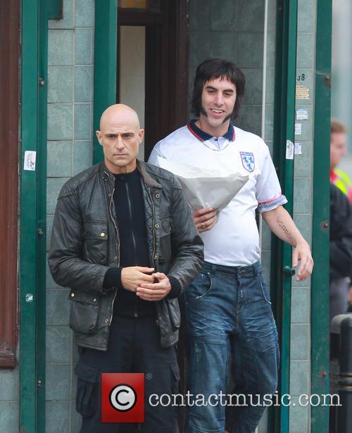 Sacha Baron Cohen and Mark Strong 12