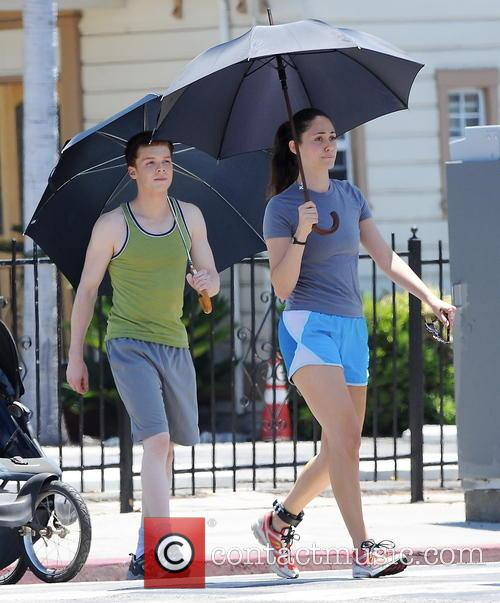 Emmy Rossum gets a workout on the set...