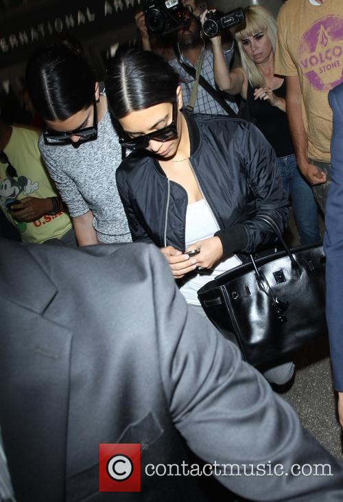 Kim Kardashian and Kendall Jenner arrive at LAX