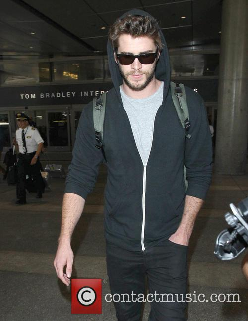 Liam Hemsworth arrives at Los Angeles International Airport (LAX)