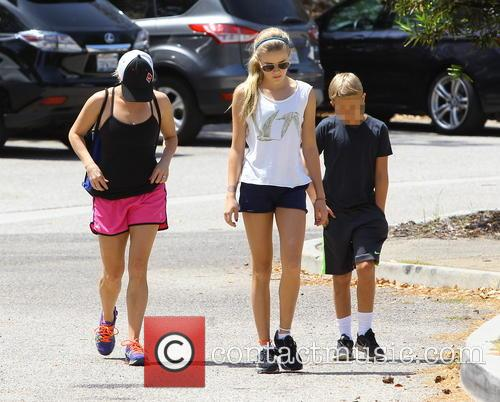Reese Witherspoon takes a walk with her children