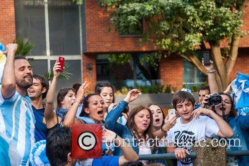 Argentinian football fans prepare to watch the 2014...