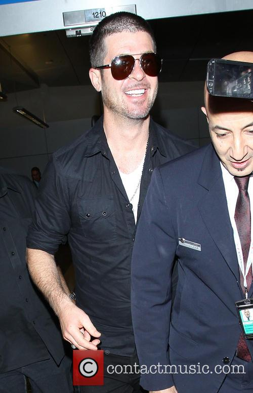 Robin Thicke arrives at Los Angeles International (LAX)...