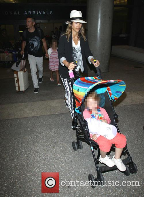 Jessica Alba arriving at LAX with her family