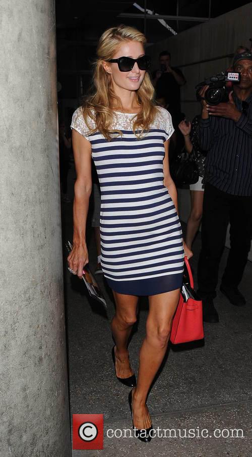 Paris Hilton arrives at Los Angeles International Airport...