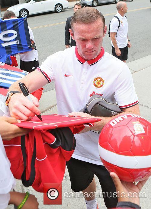 Wayne Rooney signs autographs for fans