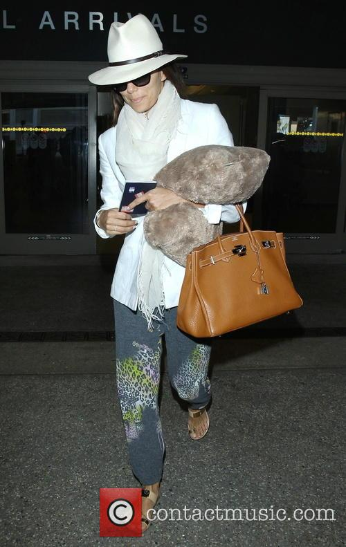 Eva Longoria arrives at Los Angeles International (LAX)...