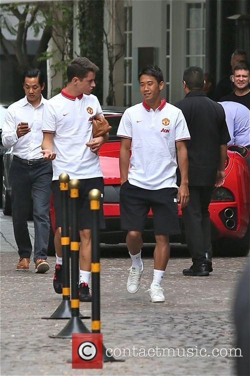 Manchester United players leaving the Beverly Wilshire Hotel