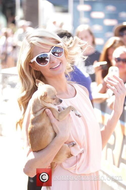 Paris Hilton seen on Extra TV Show at Universal City Walk.